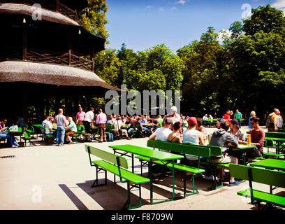 MUNICH, GERMANY -  Chinese tower beer garden at Englisher Garten in Munich offers visitors a traditional Bavarian - Stock Photo