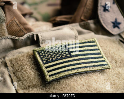 Green US flag patch on the tactical bulletproof vest, selective focus - Stock Photo