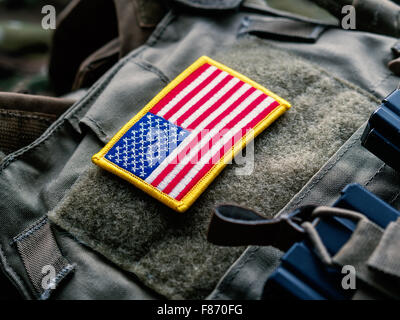 United States flag on the tactical bulletproof vest, selective focus - Stock Photo