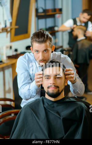 Pleasant client sitting in barber shop - Stock Photo