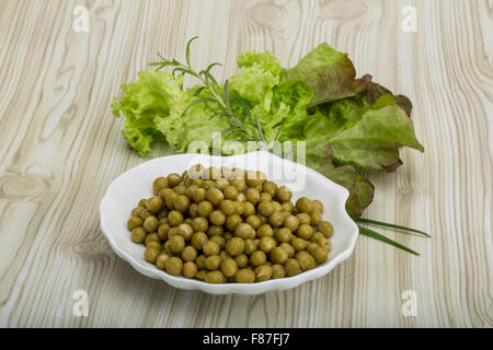 Marinated peas - in the bowl with salad leaves - Stock Photo