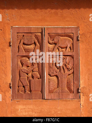 Carved wood window shutters at royal palace museum of Dahomey King Glele, Abomey, Benin - Stock Photo
