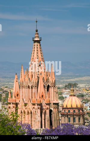 The neo gothic church of San Miguel Archangel towers over the town of San Miguel de Allende in Mexico. - Stock Photo
