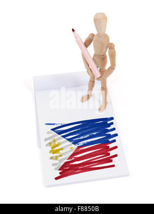 Wooden mannequin made a drawing of a flag - Philippines - Stock Photo