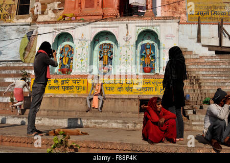 A photographer taking picture of a Naga Sadhu in Varanasi. Varanasi is the second oldest city in the world, situated - Stock Photo