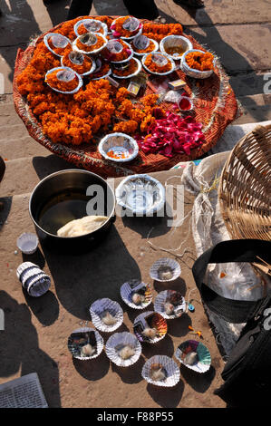 Hindu devotees in India use marigold , rose flowers, cotton, ghee, red powder, rice in all religious ceremonies, - Stock Photo
