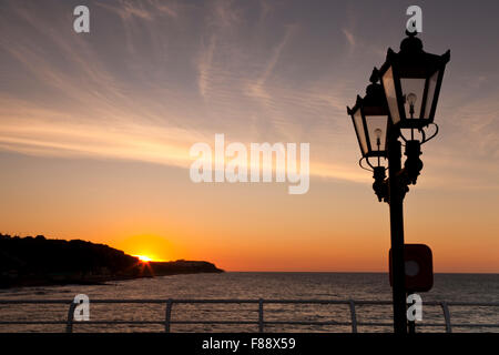 Sunset over Cromer Cliffs, Norfolk England UK, from Cromer Pier - Stock Photo
