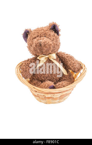 A brown teddy bear doll with red and green ribbon on its chest in white isolation. - Stock Photo