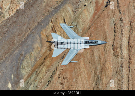 Royal Air Force Tornado GR4 Jet Fighter Flying At High Speed Through Rainbow Canyon, California. - Stock Photo