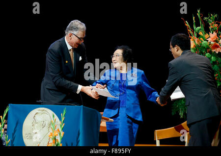 Stockholm, Sweden. 7th Dec, 2015. China's Tu Youyou (C) who won 2015 Nobel Prize in Physiology or Medicine gives - Stock Photo