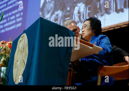 Stockholm, Sweden. 7th Dec, 2015. China's Tu Youyou (R) who won 2015 Nobel Prize in Physiology or Medicine gives - Stock Photo