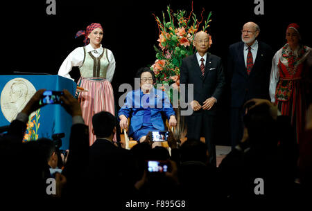 Stockholm, Sweden. 7th Dec, 2015. China's Tu Youyou (2nd L) who won 2015 Nobel Prize in Physiology or Medicine attends - Stock Photo