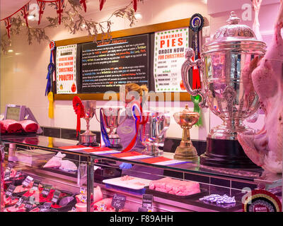 Kitson's Prize winning butchers shop in Northallerton North Yorkshire with silver and gold cups and rosettes on - Stock Photo