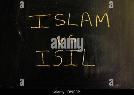 Islam vs ISIL written on a blackboard in chalk. - Stock Photo