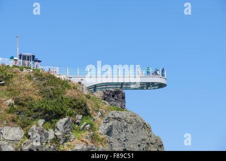transparent skywalk to see Oryukdo islands in Busan, Korea. Oryukdo means five-six island and the islands. - Stock Photo