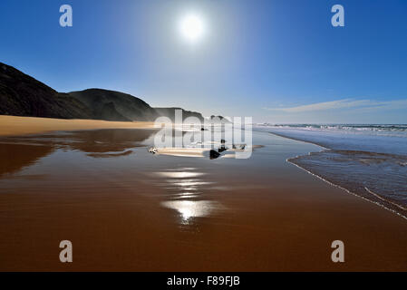 Portugal, Algarve: Scenic beach view of natural bay in Rogil - Stock Photo