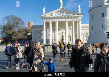 Locals at pedestrian crossing next to Vilnius Cathedral. Vilnius, Lithuania, Europe - Stock Photo