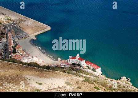 Looking down from the Rock onto the eastern side of Gibraltar showing beach and hotel development, - Stock Photo