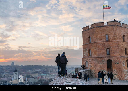Gediminas tower and city overview at dusk. Vilnius, Lithuania, Europe - Stock Photo