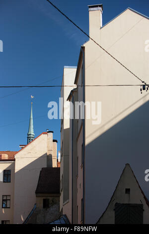 The geometry of the facades of old houses in the old city on the background of blue sky in Riga on a sunny summer - Stock Photo