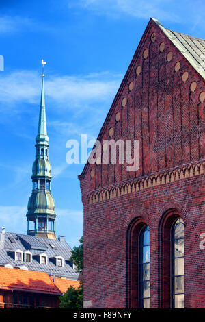 Facade of the Cathedral Church of St. Peter and against the blue sky in Riga in the summer on a sunny day - Stock Photo