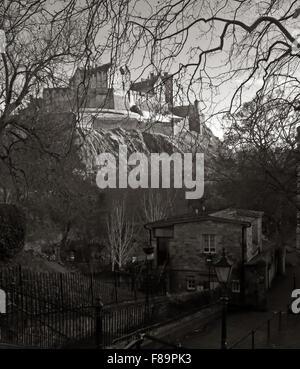 Edinburgh Castle in Winter, Scotland, UK from St Cuthberts graveyard in monochrome - Stock Photo
