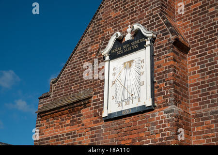 Wall mounted sundail on Moot Hall Aldeburgh Suffolk England - Stock Photo
