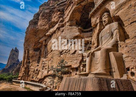 Huge Buddha statue, BIng Ling Cave and Temple Ganshu Province, China Yellow River - Stock Photo