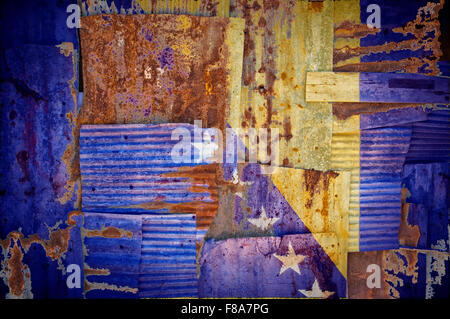 An abstract background image of the flag of Bosnia and Herzegovina painted on to rusty corrugated iron sheets - Stock Photo