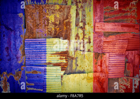 An abstract background image of the flag of Chad painted on to rusty corrugated iron sheets overlapping to form - Stock Photo
