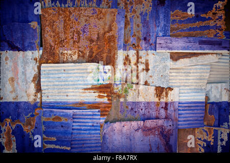 An abstract background image of the flag of El Salvador painted on to rusty corrugated iron sheets overlapping to - Stock Photo
