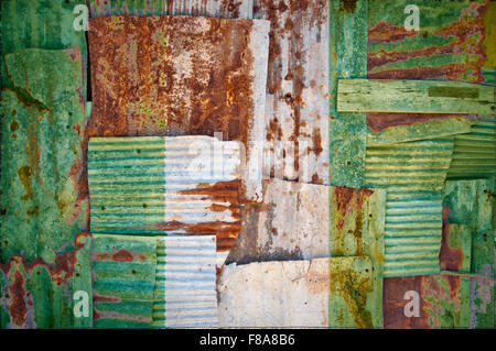 An abstract background image of the flag of Nigeria painted on to rusty corrugated iron sheets overlapping to form - Stock Photo