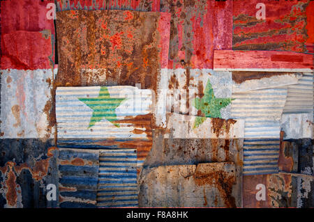 An abstract background image of the flag of Syria painted on to rusty corrugated iron sheets overlapping to form - Stock Photo