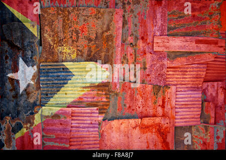 An abstract background image of the flag of Timor Leste painted on to rusty corrugated iron sheets overlapping to - Stock Photo