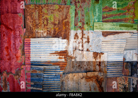 An abstract background image of the flag of United Arab Emirates painted on to rusty corrugated iron sheets overlapping - Stock Photo