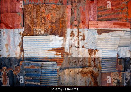 An abstract background image of the flag of Yemen painted on to rusty corrugated iron sheets overlapping to form - Stock Photo