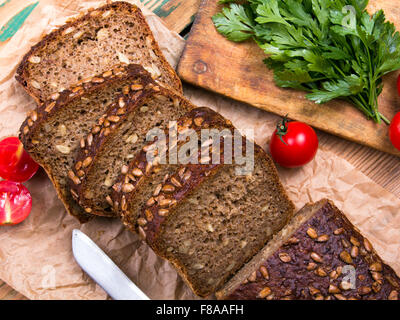 wholemeal bread with sunflower seeds and delicious fresh vegetables - Stock Photo