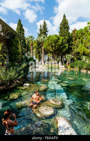 Tourists Posing For Photographs In Cleopatra's Pool, Pamukkale/Hierapolis, Denizli Provence, Turkey