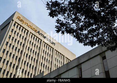 A logo sign outside of the headquarters of Reynolds American, Inc., in Winston-Salem, North Carolina on November - Stock Photo
