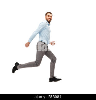 smiling young man running away - Stock Photo