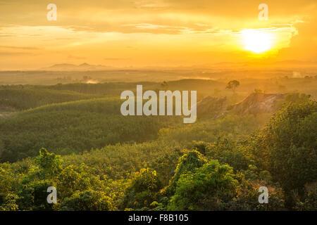 hillside meadow in high mountain in warm sunset light - Stock Photo