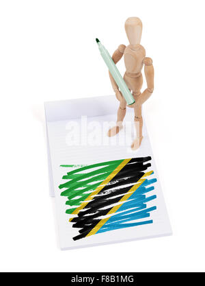 Wooden mannequin made a drawing of a flag - Tanzania - Stock Photo