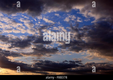 Clouds in the sky. Sunshine after rain, showers. Fluffy dark clouds, dramatic formation. - Stock Photo