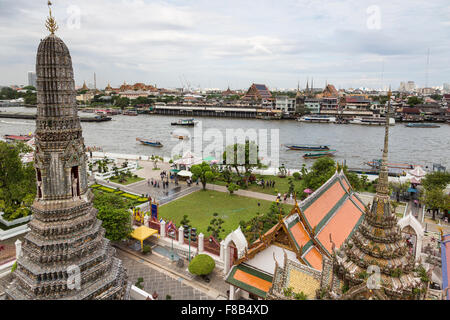 Wat Arun is a famous Buddhist temple along the Chao Praya River in Bangkok, Thailand capital city. - Stock Photo