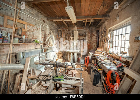 Traditional old carpenter workshop interior. - Stock Photo