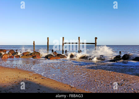 A view of old wooden sea defences on the beach at Happisburgh, Norfolk, England, United Kingdom. - Stock Photo
