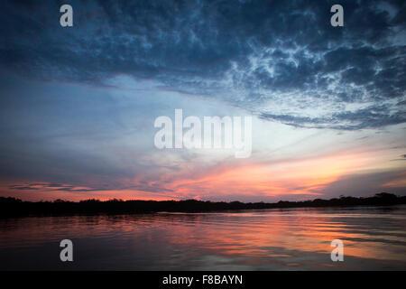 Cuyabeno protected forest reserve , Amazonia , Ecuador. Sunset on a lagoon on Rio Aguarico - Stock Photo