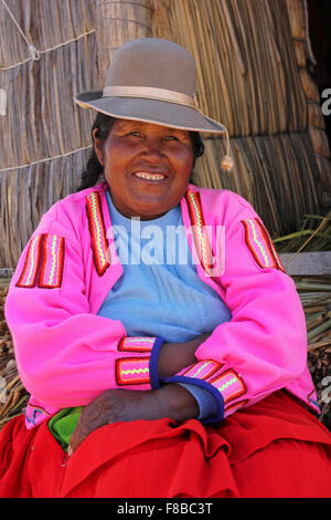 Smiling Uros Indian Woman On Floating Islands, Lake Titicaca, Peru - Stock Photo
