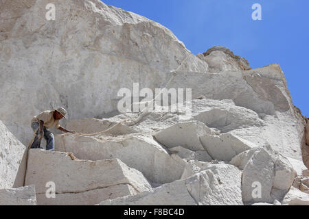 'Maestros canteros' or Quarryman In Ruta Del Sillar, Arequipa, Peru - Stock Photo