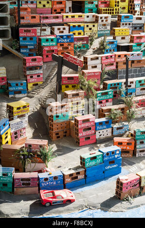 RIO DE JANEIRO, BRAZIL - OCTOBER 16, 2015: Mini depiction of a colorful favela community, a social project, at the - Stock Photo